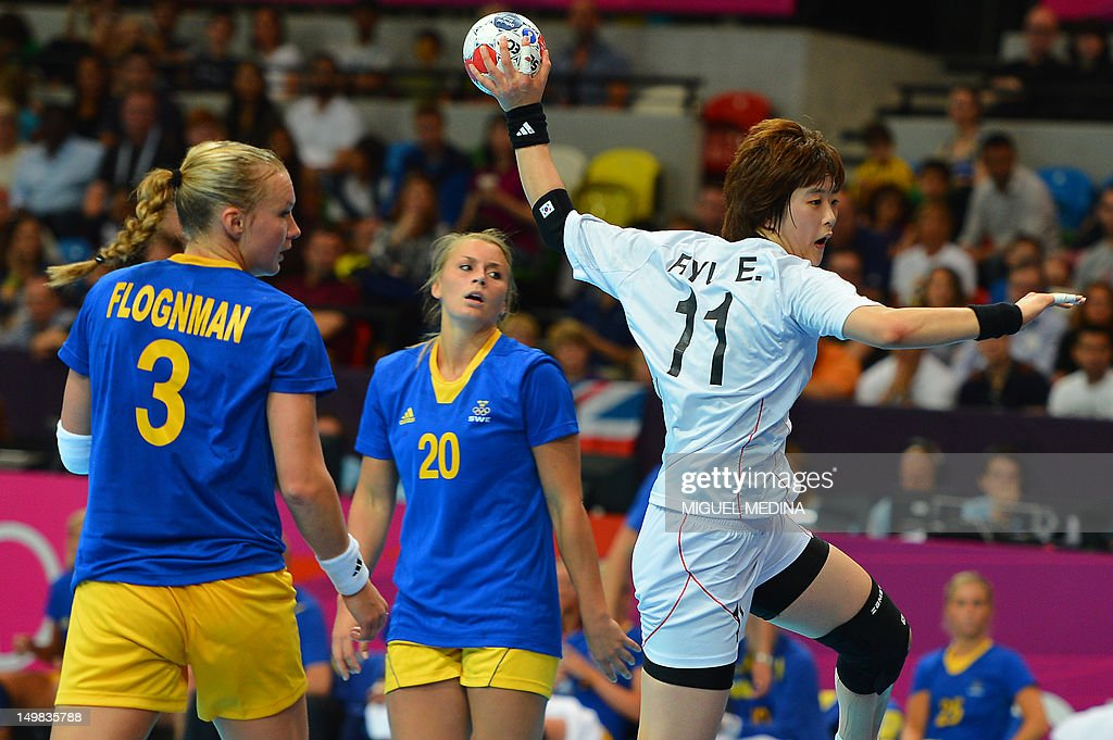 South Korea's rightback Ryu Eun Hee (R) jumps to shoot as she vies with Sweden's pivot Kristina Flognman (L) and Sweden's centreback Isabelle Gullden during the women's preliminary Group B handball match Sweden vs South Korea for the London 2012 Olympics Games on August 4, 2012 at the Copper Box hall in London.