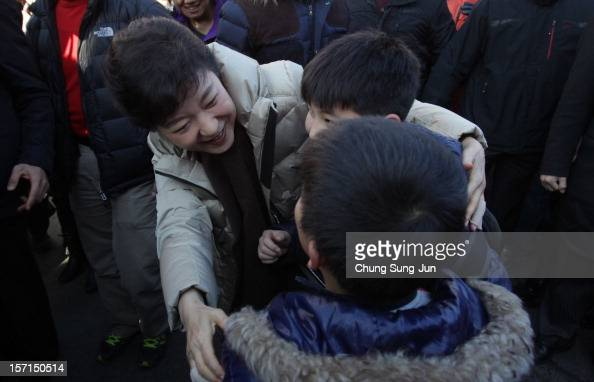 South Korea's ruling Saenuri Party's presidential candidate Park GeunHye tgreets children as she takes to downtown streets to begin her presidential...