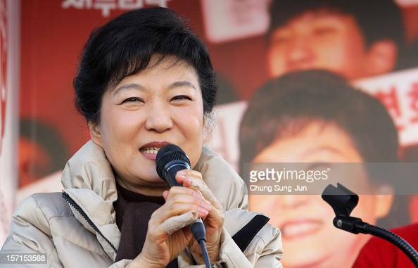 South Korea's ruling Saenuri Party's presidential candidate Park GeunHye speaks as she takes to downtown streets to begin her presidential election...