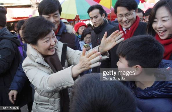 South Korea's ruling Saenuri Party's presidential candidate Park GeunHye takes to the downtown streets as she begins her presidential election...