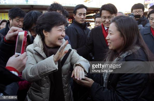 South Korea's ruling Saenuri Party's presidential candidate Park GeunHye takes to downtown streets as she begins her presidential election campaign...