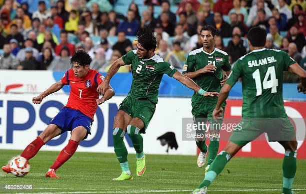 South Korea's Son Heung Min fights for the ball with Iraq's Ahmed Ibrahim during the semifinal football match between South Korea and Iraq at the AFC...
