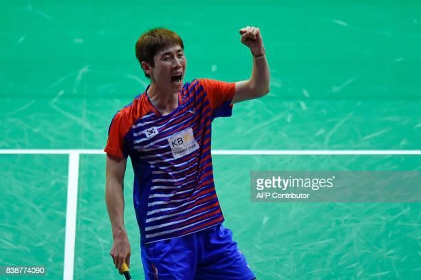 South Korea's Son Wan Ho celebrates beating India's Srikanth Kidambi during their quarterfinal men's singles match during the 2017 BWF World...