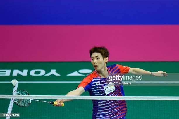 South Korea's Son Wan Ho returns against India's Srikanth Kidambi during their quarterfinal men's singles match during the 2017 BWF World...