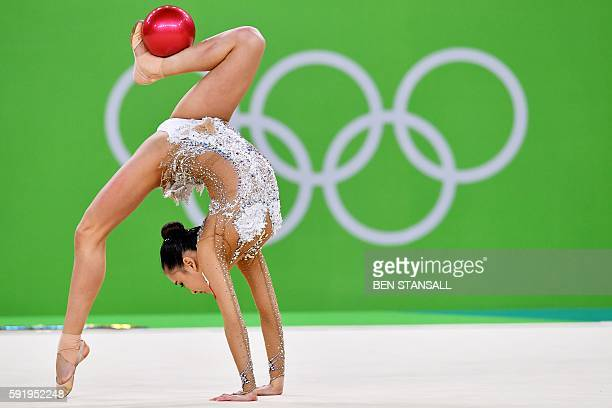 TOPSHOT South Korea's Son Yeon Jae competes in the individual allaround qualifying event of the Rhythmic Gymnastics at the Olympic Arena during the...