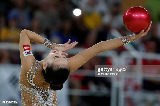 TOPSHOT South Korea's Son Yeon Jae competes in the individual allaround final event of the Rhythmic Gymnastics at the Olympic Arena during the Rio...