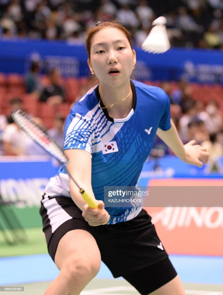 South Korea s Sung Ji Hyun hits a return against Japan s Yui