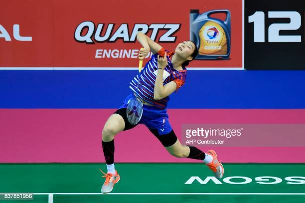 South Korea's Sung Ji Hyun returns against India's Tanvi Lad during their round two women's singles match during the 2017 BWF World Championships of...