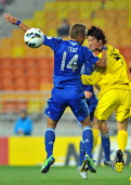 South Korea's Suwon Bluewings forward Chong TeSe jumps for the ball with Japan's Kashiwa Reysol defender Suzuki Daisuke during the AFC Champions...