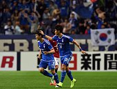 South Korea's Suwon Bluewings midfielder Ko ChaWon is congratulated by defender Shin SeGyu following his goal during the AFC champions league group G...