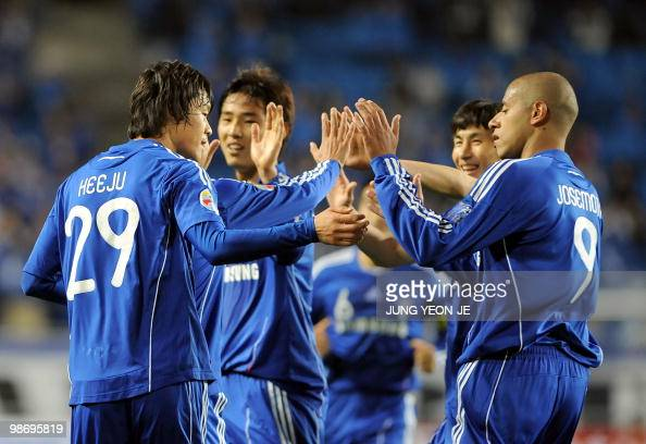 South Korea's Suwon Bluewings Rodrigues Kwak HeeJu celebrates his goal with teammates against Singapore's Armed Forces FC during a Group G football...