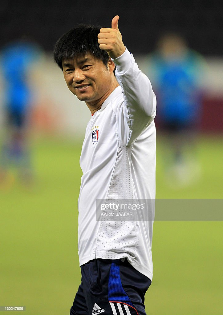 South Korea's Suwon Samsung Bluewings coach Yoon Sung-Hyo gives a thumb-up during a training session at Al-Sadd Stadium in Doha on October 25, 2011 on the eve of his team's AFC Champions League match against Qatar's Al-Sadd.