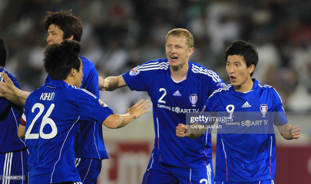 South Korea's Suwon Samsung Bluewings players celebrate after scoring a goal against al-Sadd during their semi-final football match in the AFC Champions League in Doha, on October 26, 2011. Suwon Samsung Bluewings won the match 1-0.
