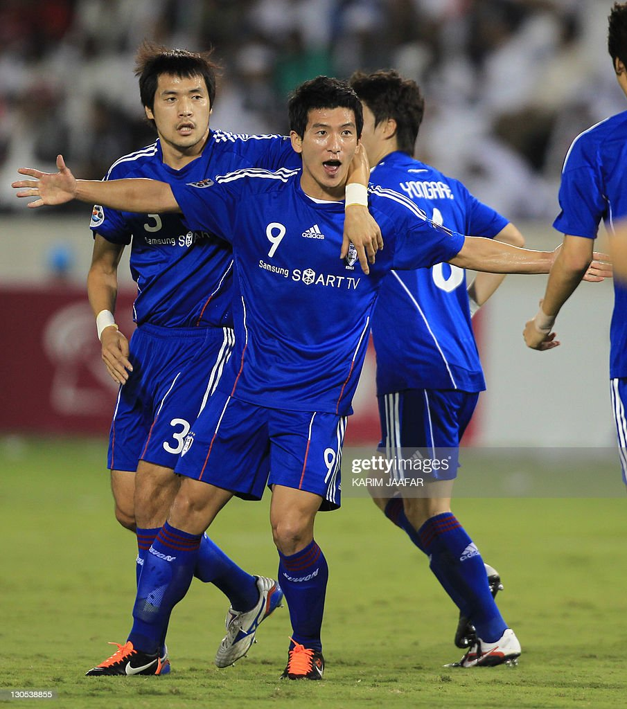 South Korea's Suwon Samsung Bluewings players celebrate after scoring a goal against Qatar's al-Sadd club during their semi-final football match in the AFC Champions League in Doha, on October 26, 2011. Suwon Samsung Bluewings won the match 1-0.