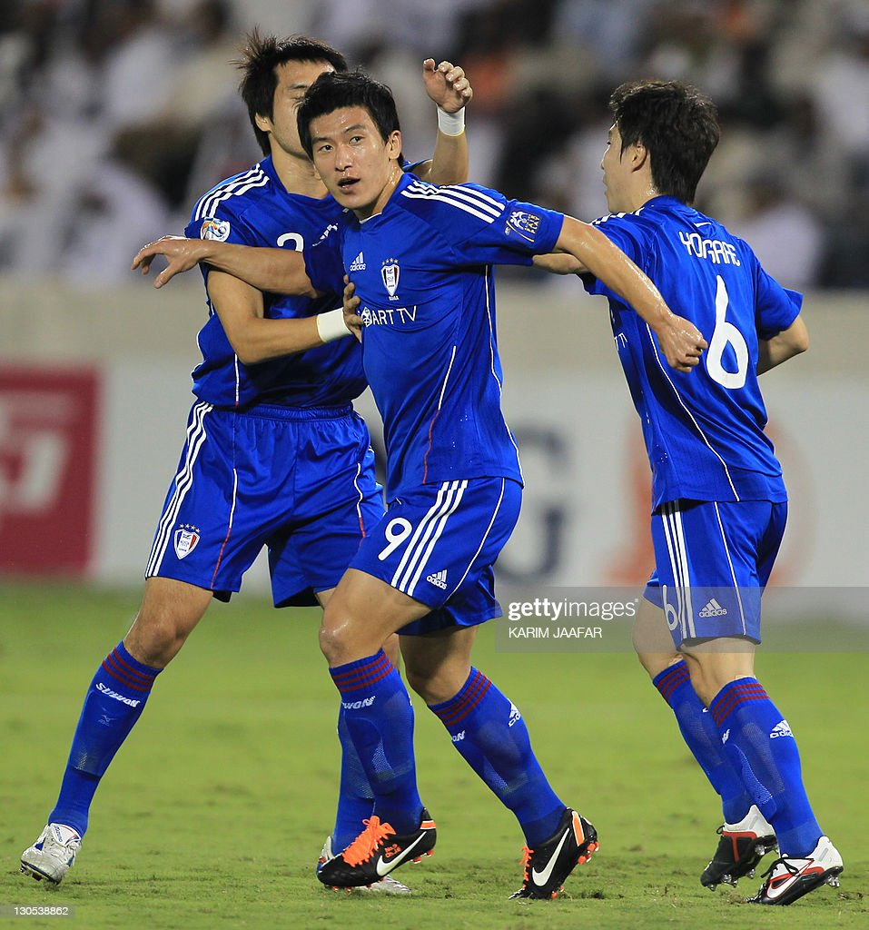 South Korea's Suwon Samsung Bluewings players celebrate after scoring a goal against Qatar's al-Sadd during their semi-final football match in the AFC Champions League in Doha, on October 26, 2011. Suwon Samsung Bluewings won the match 1-0.