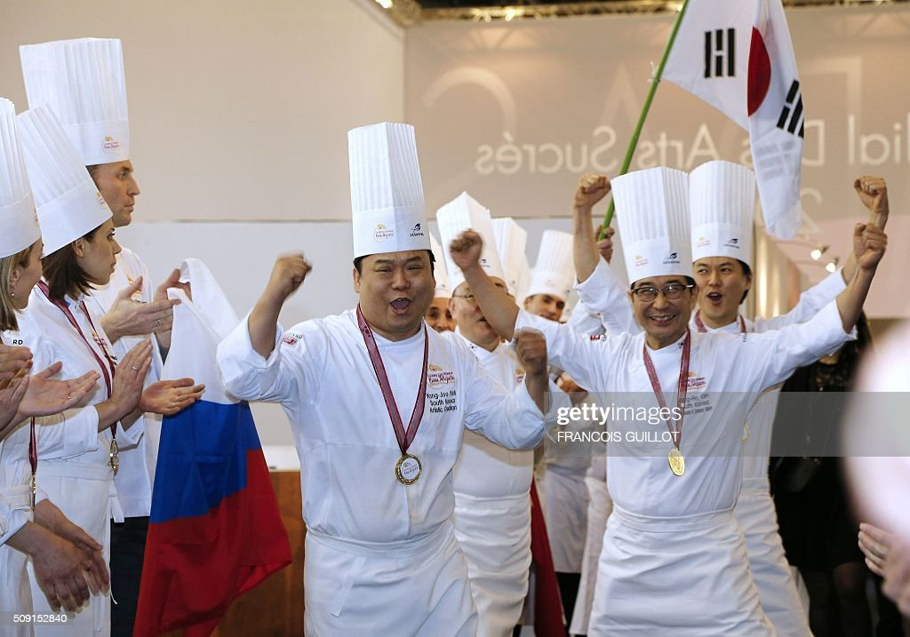 South Korea's team celebrate after winning the first place during the Bakery world cup, as part of the Europain fair, on February 9, 2016, in Villepinte near Paris. / AFP / FRANCOIS GUILLOT