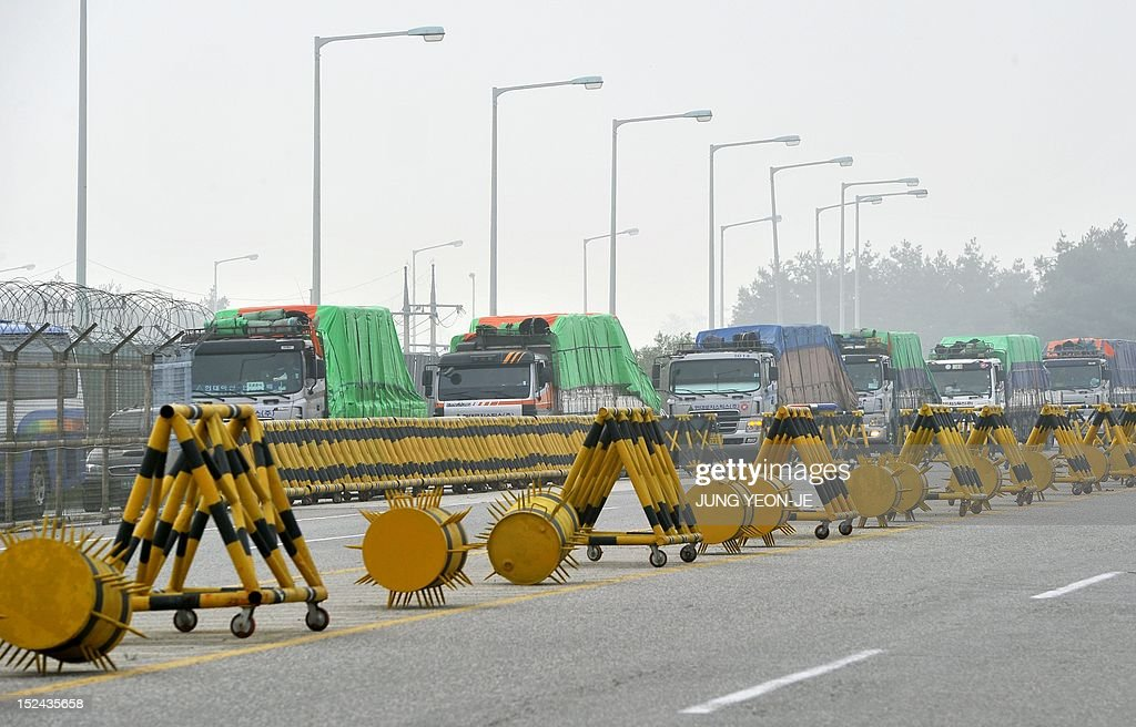 South Korea's trucks carrying 500 tons of flour for North Korean flood victims drive past a military checkpoint near the inter-Korean border in Paju, north of Seoul, on September 21, 2021. A Seoul charity group sent flood aid to North Korea since the communist state was hit by a string of deadly floods and typhoons this summer.