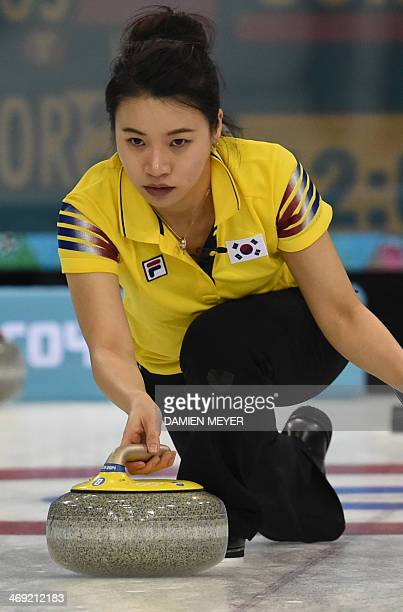 South Korea's Um MinJi throws the stone during the Women's Curling Round Robin Session 6 match South Korea vs Russia at the Ice Cube Curling Center...