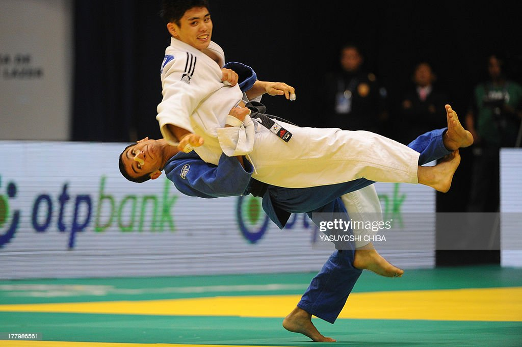 South Korea's Won Jin Kim (top) competes with Azerbaijan's Orkhan Safarov in the Men's 60kg category of the IJF World Judo Championship in Rio de Janeiro, Brazil, on August 26, 2013.
