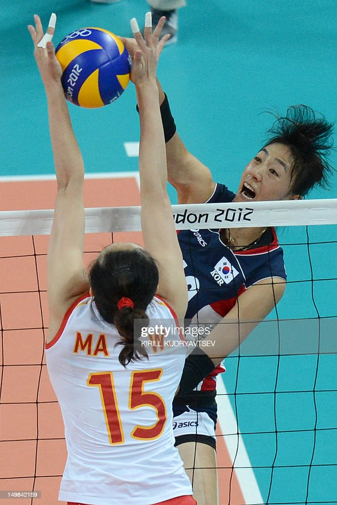 South Korea's Yang Hyo-Jin (R) spikes as China's Ma Yunwen attempts to block during the Women's preliminary pool B volleyball match between China and South Korea in the 2012 London Olympic Games in London on August 5, 2012.