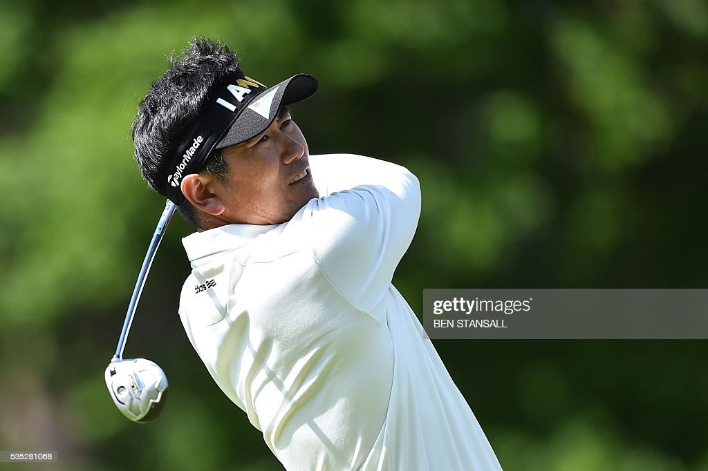 South Korea's Yang Yong-Eun (aka YE Yang) plays a tee shot on the 8th hole during the fourth day of the golf PGA Championship at Wentworth Golf Club in Surrey, south west of London, on May 29, 2016. / AFP / BEN