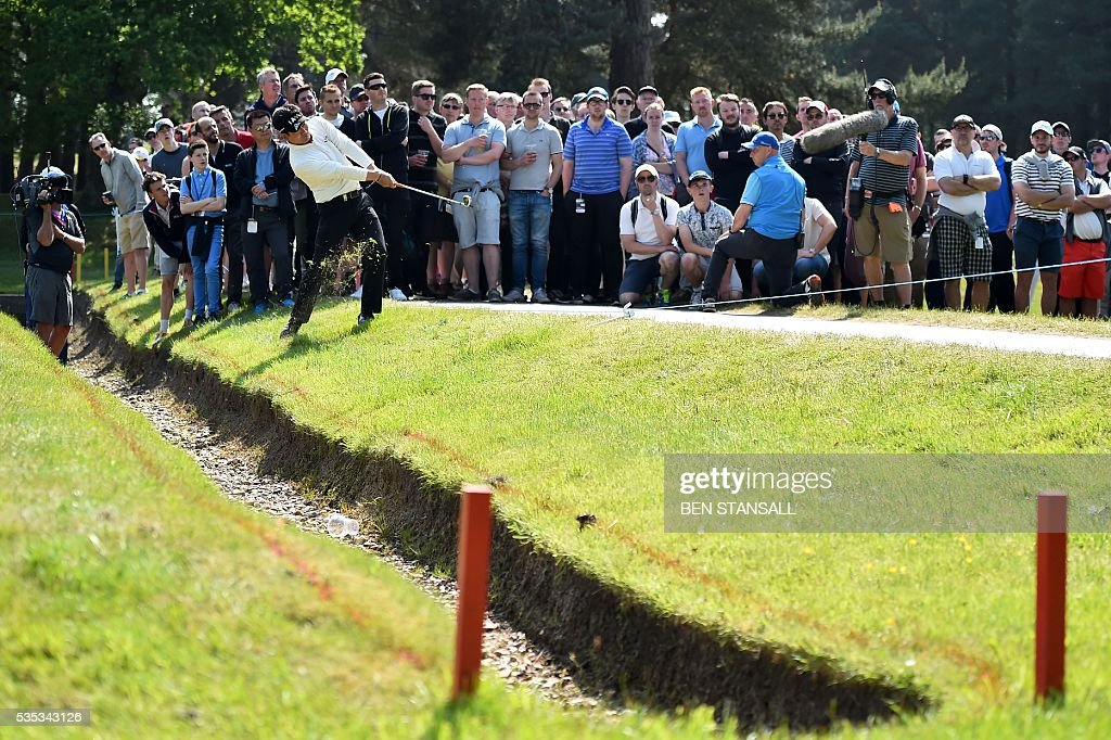 South Korea's Yang Yong-Eun (aka YE Yang) plays from the rough on the 11th hole during the fourth day of the golf PGA Championship at Wentworth Golf Club in Surrey, south west of London, on May 29, 2016. / AFP / BEN