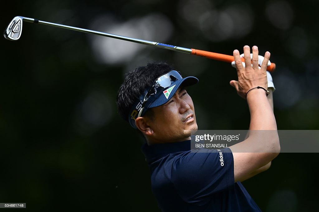South Korea's Yang Yong-Eun Yang (aka YE Yang) hits his tee shot on the 2nd hole during the second day of the PGA Championship at Wentworth Golf Club in Surrey, south west of London, on May 27, 2016. / AFP / BEN
