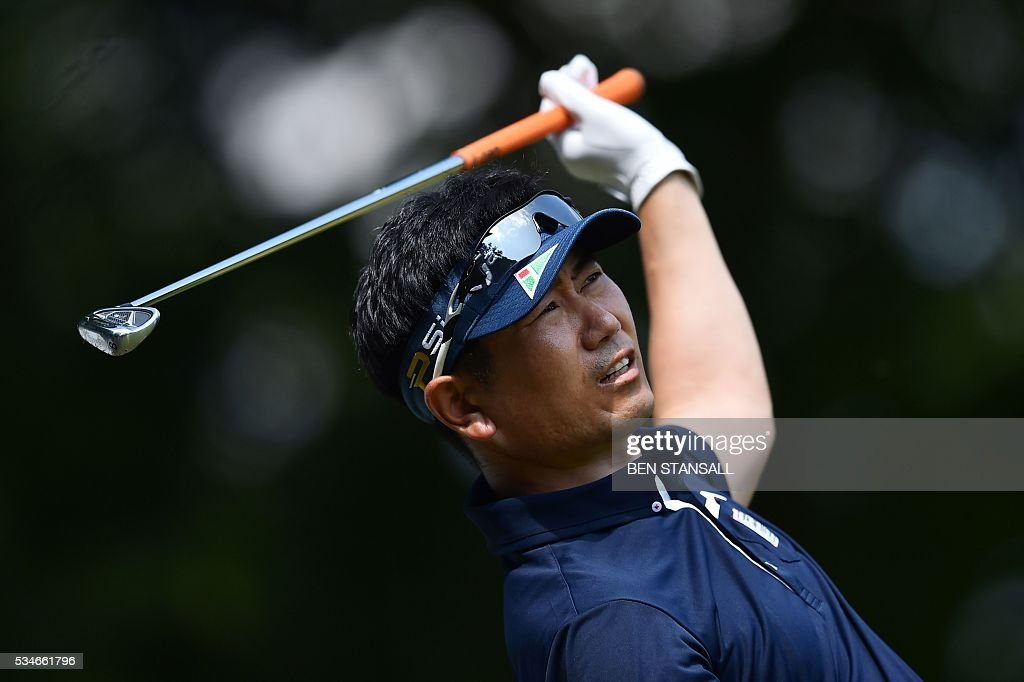 South Korea's Yang Yong-Eun Yang (aka YE Yang) reacts after hitting his tee shot on the 2nd hole during the second day of the PGA Championship at Wentworth Golf Club in Surrey, south west of London, on May 27, 2016. / AFP / BEN