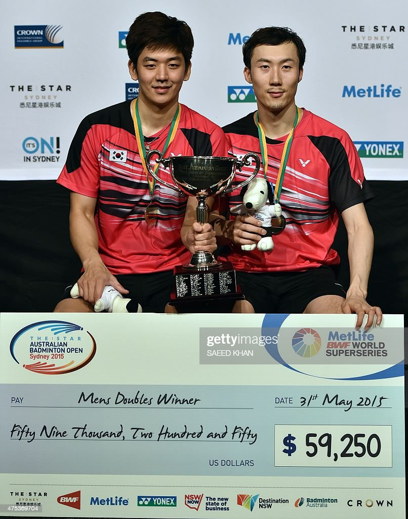 South Korea s Yoo Yeon Seong L and Lee Yong Dae pose with their