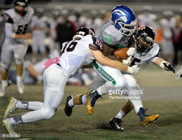South Lakes' Albert Mensah center breaks up field for as long gain during South Lakes defeat of Madison 21 13 in football at South Lakes High School...