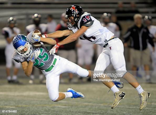 South Lakes' Andrew Funaki left intercepts a 1st quarter pass intended for Madison's Nick Conforti during South Lakes defeat of Madison 21 13 in...