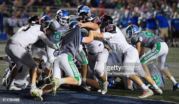 South Lakes defense stops Madison on the 1 yard line on a 4th down play in the 3rd quarter during South Lakes defeat of Madison 21 13 in football at...