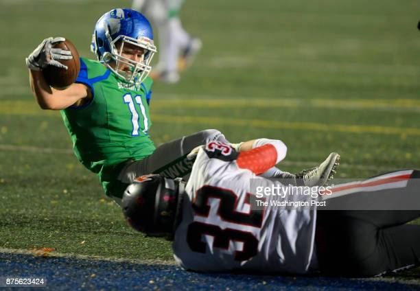 South Lakes' Noah Seneca left is brought down on the one yard line by Madison's Tommy Williams on a 1st quarter run during South Lakes' defeat of...
