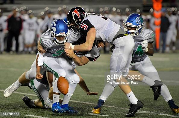 South Lakes QB Devin Miles is sacked and fumbles the ball in the first quarter during South Lakes defeat of Madison 21 13 in football at South Lakes...