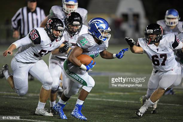 South Lakes' Spencer Alston center gains a few yards during South Lakes defeat of Madison 21 13 in football at South Lakes High School in Reston VA...