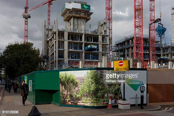 South Londoners walk past a regeneration project hoarding image at Elephant Castle on 6th October 2016 in London England London borough of Southwark...