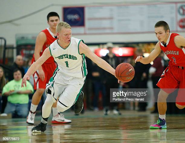 South Massabesic vs Scarborough quarterfinal at Portland Expo on Thursday February 11 2016 Ryan Gullikson of Massabesic handles the ball after making...