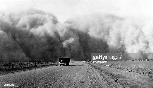 South of Lamar Colorado a large dust cloud appears behind a truck traveling on highway 59 May 1936