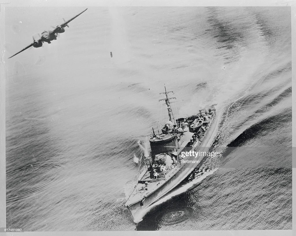 Death To A Jap Sea Hound Crewmen of a small Jap war vessel scurry for cover as a B25 bomber unleashes death from the skies of the Bismarck sea The...