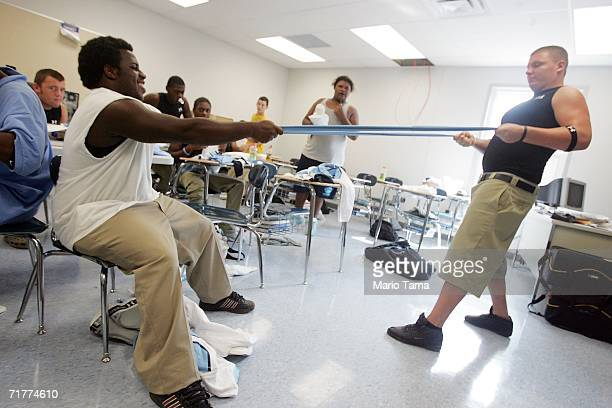 South Plaquemines High School football players stretch out socks in a modular classroom because they have no locker room as they prepare for their...