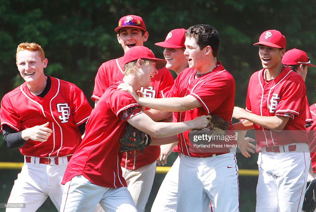 South Portland pitchers Griffin Kelley and Brad Sowerby celebrate with their team after beating Marshwood 98 in semifinal baseball at Marshwood...
