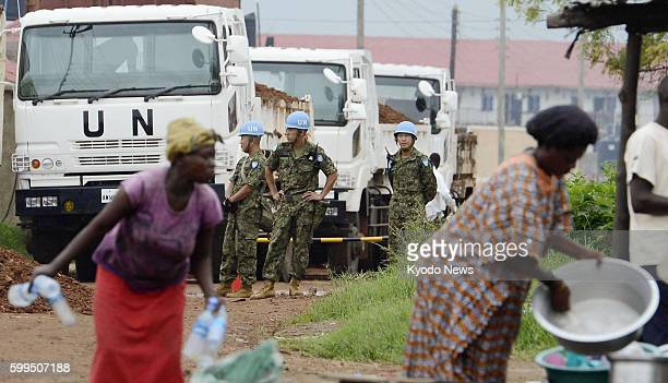 JUBA South Sudan Members of an engineering unit of Japan's SelfDefense Forces are pictured with local people in Juba on July 5 2012 The SDF members...