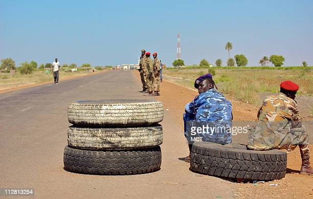 South Sudan police and army commandos man the final checkpoint at the border crossing at Wonthau between Sudan's northern and southern territories...
