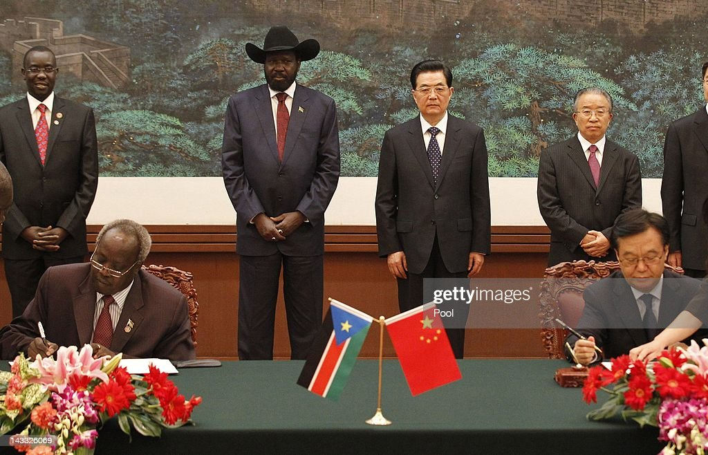 South Sudan president Salva Kiir (C L) and Chinese president <a gi-track='captionPersonalityLinkClicked' href=/galleries/search?phrase=Hu+Jintao&family=editorial&specificpeople=203109 ng-click='$event.stopPropagation()'>Hu Jintao</a> (C R) attend a signing ceremony at Great Hall of the People on April 24, 2012 on Beijing, China. President Kiir confirmed that he sees China as an important and strategic partner, while the meeting was held against a backdrop of recent violence between the the newly formed independent nation of South Sudan and Sudan, both countries from which China purchases oil.
