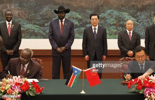 South Sudan president Salva Kiir and Chinese president Hu Jintao attend a signing ceremony at Great Hall of the People on April 24 2012 on Beijing...