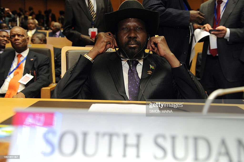 South Sudan president Salva Kiir fixes his earphones during the opening ceremony of the 20th Ordinary Session of The Assembly of the Heads of State and Government (OSOA) of the African Union (UA) in Addis Ababa Ethiopia on January 27, 2013. African leaders are scheduled to discuss the conflict in Mali and seek to speed up the deployment of an African force there as well as discussing the political standoff between the Sudans.