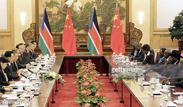 South Sudan President Salva Kiir speaks to Chinese President Hu Jintao during their meeting at the Great Hall of the People in Beijing on April 24...