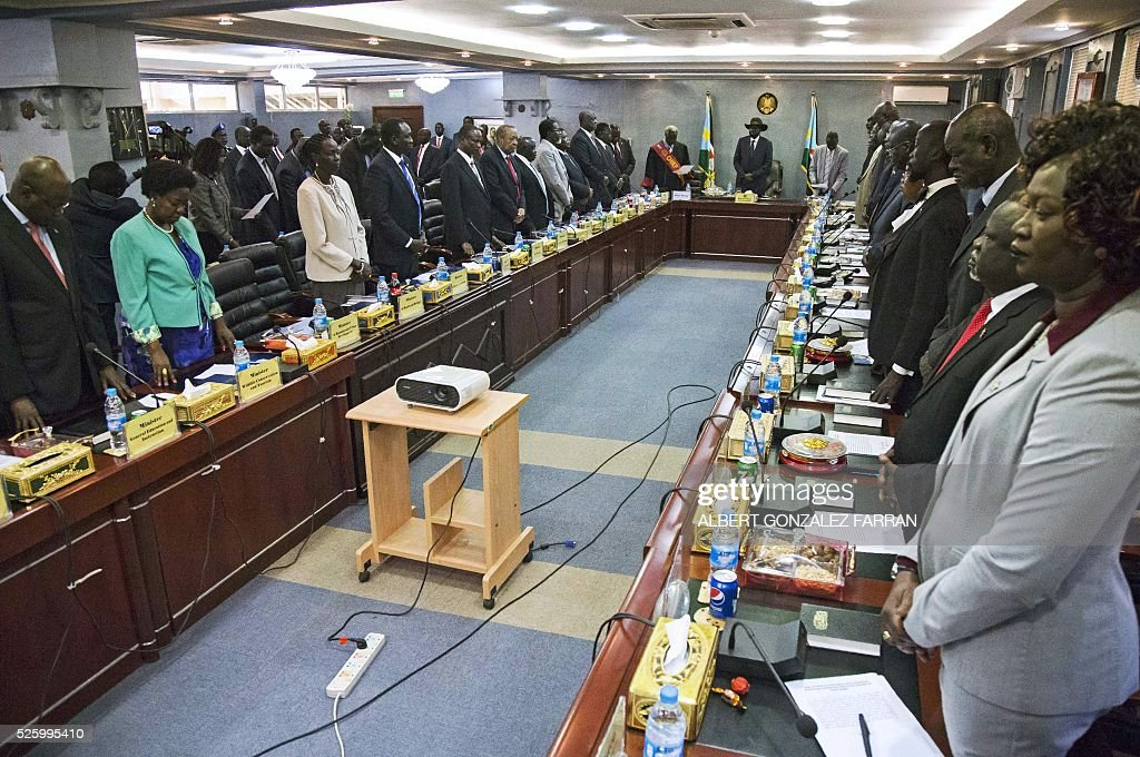 South Sudan President Salva Kiir (C) stands along with the 30 members of the new cabinet of the Transitional Government at the Cabinet Affairs Ministry in Juba on April 29, 2016. South Sudan President Salva Kiir has named his transitional unity government, sharing power with ex-rebels in a key step in a long-delayed peace process, a decree read out on April 29 said. Under terms of an August 2015 peace deal, the 30 ministerial posts are split between Kiir, former rebel chief turned first vice president Riek Machar, opposition and other parties. FARRAN