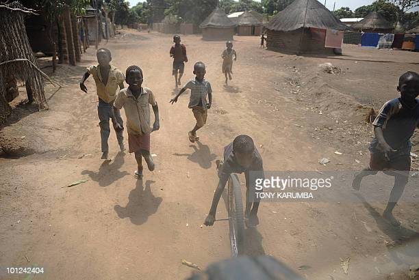 South Sudanese boys play on April 3 2009 at Wau 513 km from Juba an area where the population is exposed to malaria a vectorborne infectious...