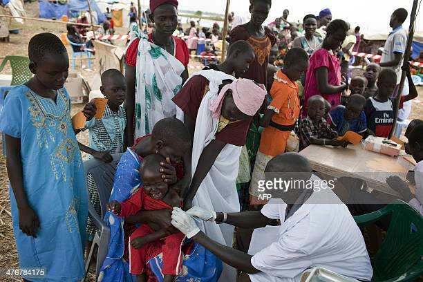 A South Sudanese child receives measles vaccination given by Medecins Sans Frontieres in an isolated makeshift IDP camp for Dinka ethnic group placed...